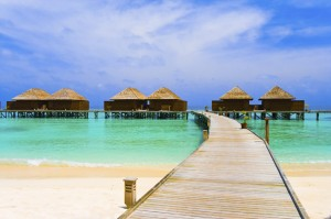 Maldives bungalows with thatched roofs over water