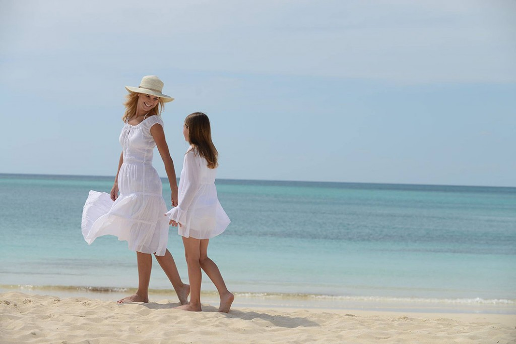 Mother and daughter strolling on beach