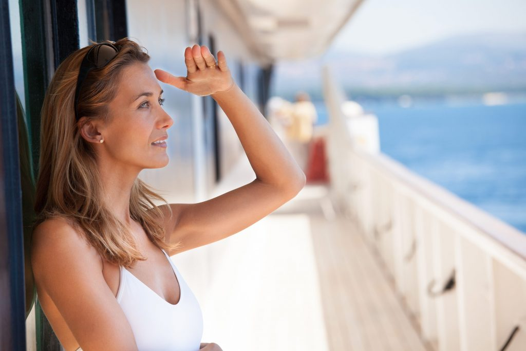 woman looking from yacht