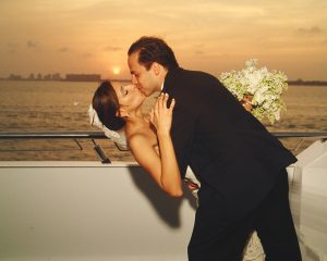 bride and groom kissing on yacht