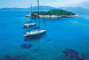 2 sailboats at anchor