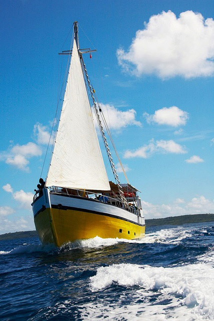 yellow wooden sailboat