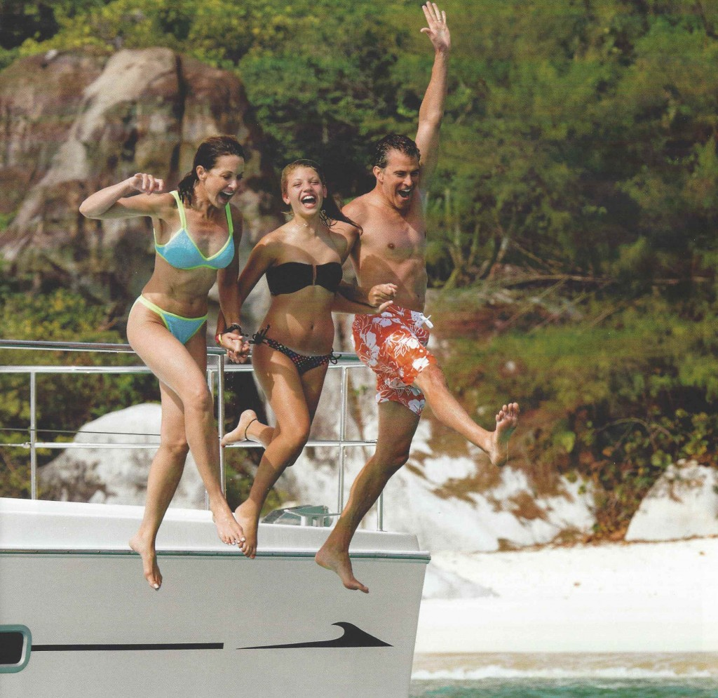 3 people jumping off yacht