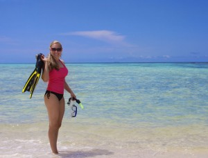 Watersports girl with snorkeling equipment