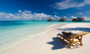 lounge chair on a white sand beach